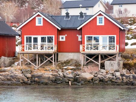rorbuer: Two red rorbu cabins in Stokmarknes on Hadsel Island, Vesteralen, Norway Stock Photo