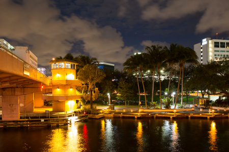 ft lauderdale: Night view of bridge over New River, Riverwalk promenade and Huizenga Park in downtown Fort Lauderdale, Florida, USA Stock Photo