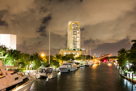 fort lauderdale: Night view of New River with yachts, draw bridge and highrise condominium building in downtown Fort Lauderdale, Florida, USA Editorial