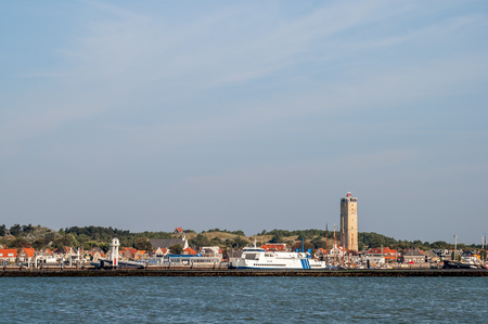 Skyline of West-Terschelling town and harbour, and lighthouse Brandaris on West-Frisian island Terschelling Netherlands