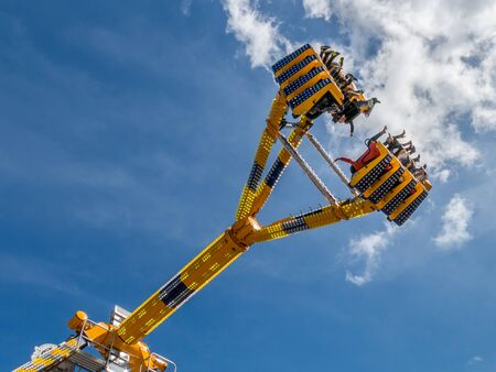ultimate: People in a vertical ride in the sky in Ultimate on fun fair on Kings Day in the Netherlands Editorial