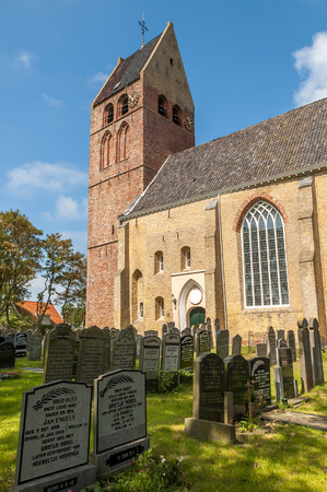 Old protestant church and cemetery in Hollum village on the West Frisian island Ameland, Netherlands