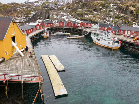 rorbuer: Fishing boats and rorbu cabins in Nusfjord harbour, Lofoten, Norway