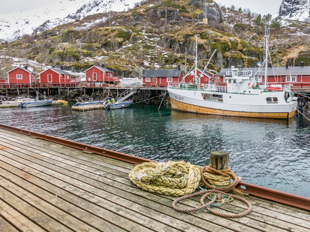 rorbu: Fishing boats and rorbu cabins in Nusfjord harbour, Lofoten, Norway