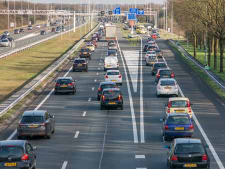 holland: HILVERSUM, NETHERLANDS - APR 14, 2015: Traffic jam after accident during rush hour on motorway A1, Hilversum in the Netherlands Editorial