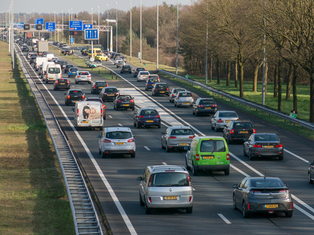 HILVERSUM, NETHERLANDS - APR 14, 2015: Traffic jam after accident during rush hour on motorway A1, Hilversum in the Netherlands Editorial