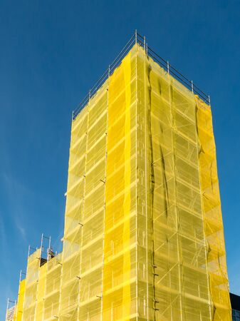 church tower: HILVERSUM, NETHERLANDS - APR 21, 2015: Scaffold construction to renovate church tower building in the Netherlands