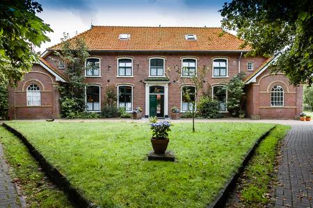 Old Dutch house in Hollum village on the West Frisian island Ameland, Netherlands
