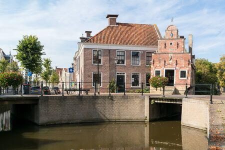 Old corn bearers house on Zilverstraat canal in the city of Franeker, Friesland, Netherlands 写真素材