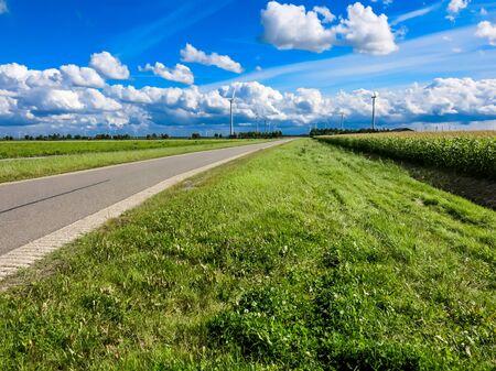 flevoland: Country road, farmland and wind turbines in Flevoland polder, the Netherlands