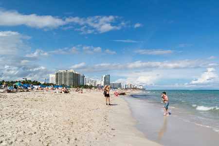 miami south beach: MIAMI, USA - DEC 9, 2015: People enjoying sunshine on South Beach of Miami Beach, Florida, USA