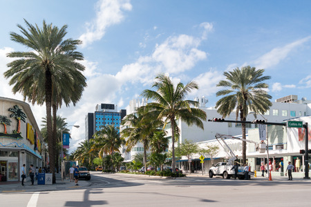 collins: Street scene of crossing Lincoln Road and Collins Avenue in South Beach district of Miami Beach, Florida, USA Editorial