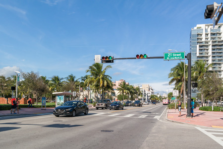 streetscene: People and traffic on Collins Avenue at crossing 21th Street in South Beach district of Miami Beach, Florida, USA Editorial