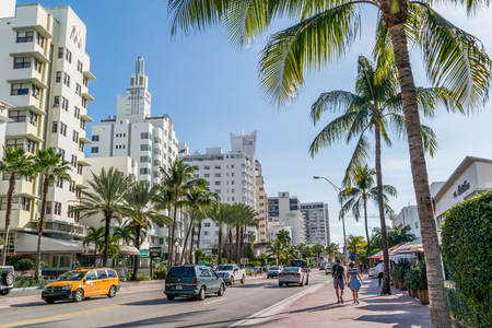 collins: People and traffic on Collins Avenue in South Beach district of Miami Beach, Florida, USA