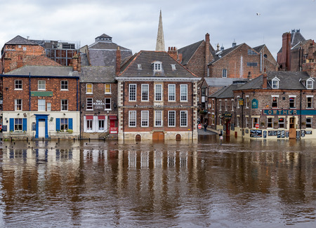 rainfall: YORK, ENGLAND, UK - OCTOBER 23, 2004: River Ouse bursted its banks due to heavy rainfall. View on Kings Staith, York, Yorkshire, England, UK