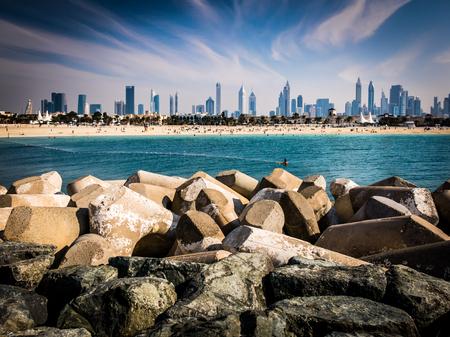 united arab emirate: DUBAI, UNITED ARAB EMIRATES - JAN 24, 2014: Jumeirah Beach and city skyline of Dubai, United Arab Emirates Editorial