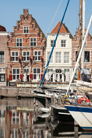 literas: GOES, NETHERLANDS - JUN 9, 2005: Yachts in the city harbour and Kleine Kade with old houses in the city of Goes in Zeeland, Netherlands Editorial