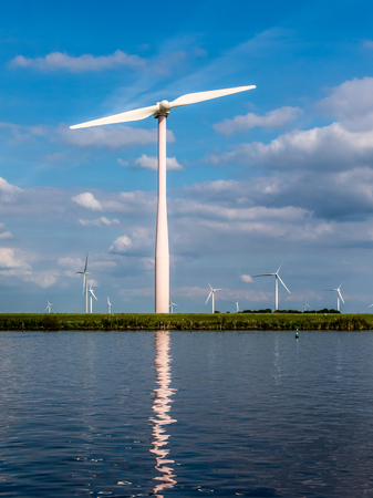 bordering: Waterfront wind power turbine in Flevoland polder in the Netherlands