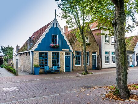 VLIELAND, NETHERLANDS - SEP 21, 2014: Houses in Main Street Dorpsstraat of East-Vlieland, town on the West Frisian island of Vlieland, Netherlands