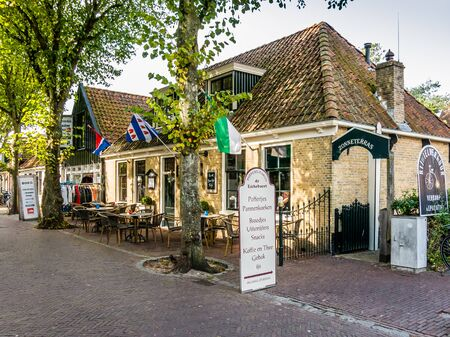 VLIELAND, NETHERLANDS - SEP 22, 2014: Restaurant in historic house in old town of East-Vlieland on Vlieland island in Waddensea, Netherlands