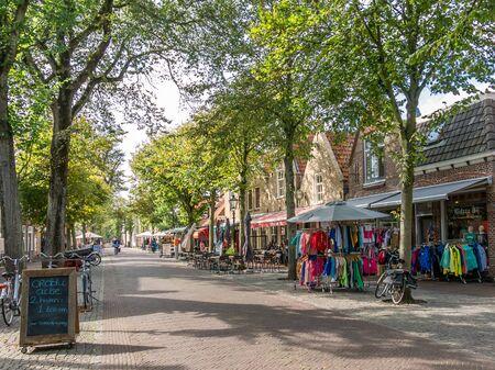 main street: VLIELAND, NETHERLANDS - SEP 22, 2014: Shops in Dorpsstraat, Main Street East-Vlieland on Vlieland island in the Waddensea, Netherlands Editorial
