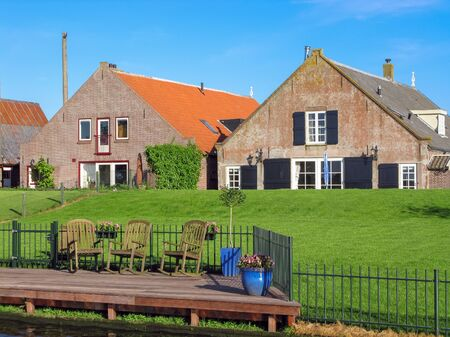eem: Farm houses with lawn at dyke in the Netherlands
