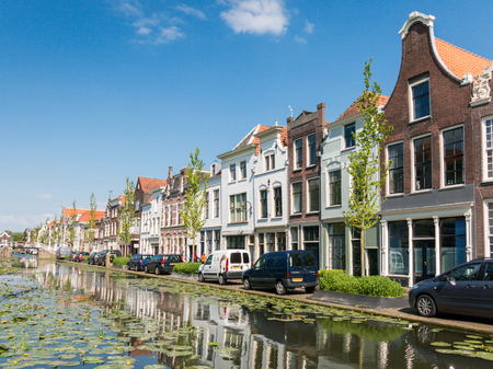 Facades of old houses on Turfmarkt canal in Gouda, Netherlands