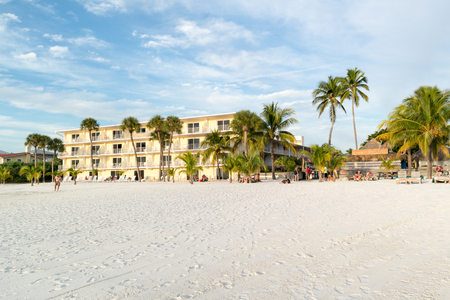 myers: FORT MYERS BEACH, USA - DEC 10, 2015: Hotel and people on beach of Fort Myers Beach on Estero Island at west coast of Florida
