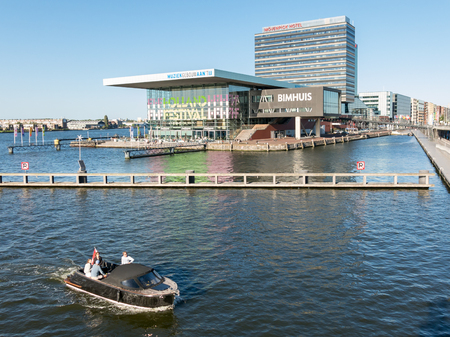 AMSTERDAM, NETHERLANDS - JUN 6, 2015: Waterfront view with Music Building on the IJ, Bimhuis, Zouthaven restaurant and hotel in Amsterdam