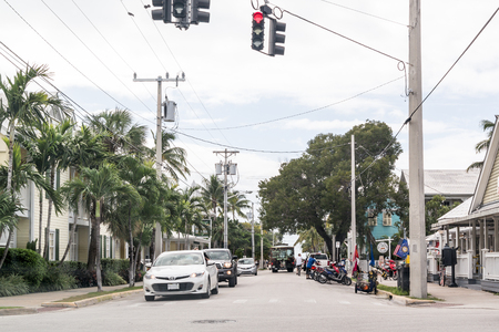 streetscene: People and traffic on South Street in Key West,  Florida Keys, USA
