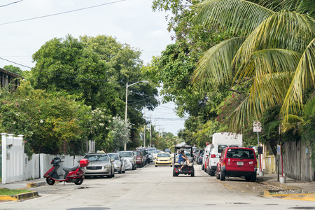 streetscene: Street scene with traffic and parked cars in Key West, Florida Keys, USA