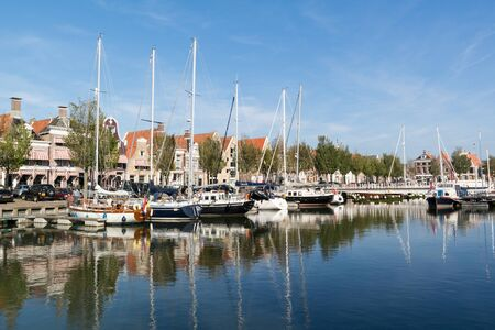 friesland: Noorderhaven canal with boats and houses in historic old town of Harlingen, Friesland, Netherlands Editorial