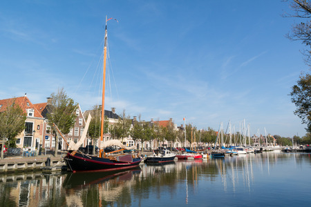 Noorderhaven canal with boats and houses in historic old town of Harlingen, Friesland, Netherlands Editorial