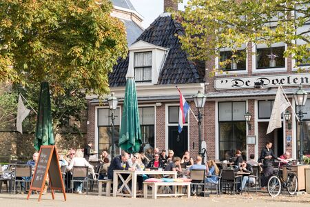 friesland: People on outdoor terrace of cafe on Breedeplaats square in the city of Franeker, Friesland, Netherlands Editorial