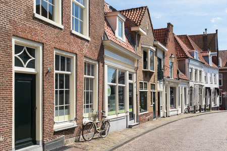 gables: Street with row of historic houses in old town of Amersfoort in Utrecht province, Netherlands Editorial