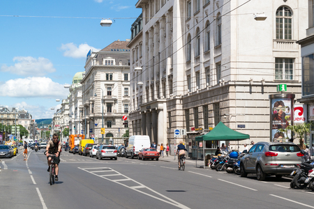 bicyclists: Street scene of Schottengasse with bicyclists and cars in old city centre of Vienna, Austria