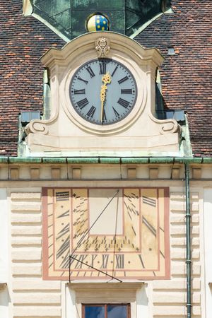 hofburg: Sundial and clock in facade of Amalienburg, part of Hofburg Imperial Palace on In der burg square in Vienna, Austria Editorial