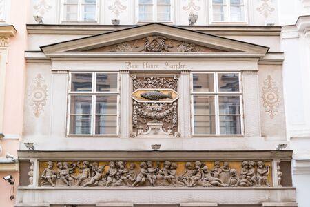 inner city: Decorated facade of house Zum Blauen Karpfen in Annagasse street in inner city of Vienna, Austria Stock Photo