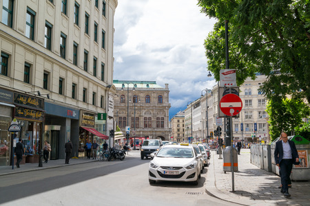 inner city: Street scene of Albertina square and Tegetthoffstrasse with State Opera, traffic and people in inner city of Vienna, Austria