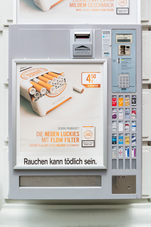 automat: Cigarette vending machine on wall in street in inner city of Vienna, Austria