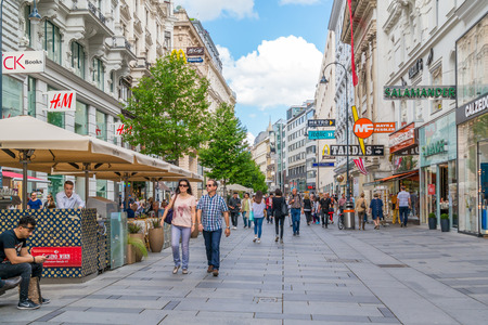 People walking and shopping in Karntnerstrasse in inner city of Vienna, Austria