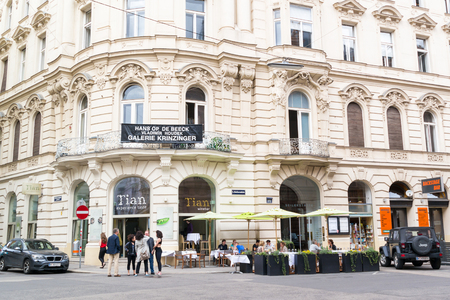 Street scene of Seilerstatte with people on outdoor terrace of restaurant in inner city of Vienna, Austria