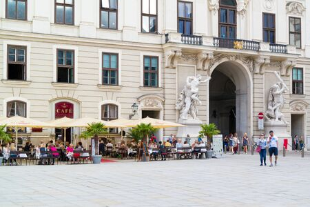 hofburg: People on terrace of outdoor cafe and Michaels Gate, In der burg square, Imperial Palace Hofburg in Vienna, Austria Editorial