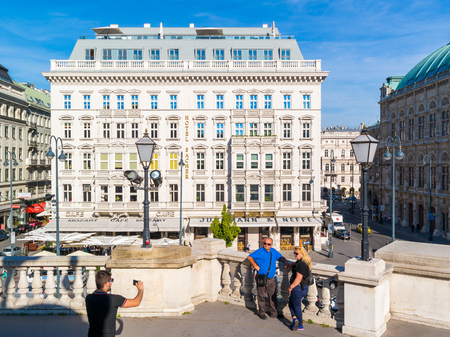 inner city: Tourists taking photos and Hotel Sacher on Albertina Square in inner city of Vienna, Austria Editorial