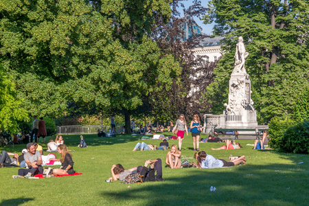 mozart: People relaxing near Mozart monument in Burggarten Gardens, Hofburg in downtown Vienna, Austria Editorial