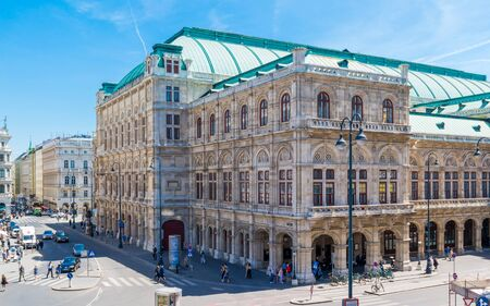 streetscene: State Opera House on Albertina Square with people and traffic in downtown Vienna, Austria Editorial