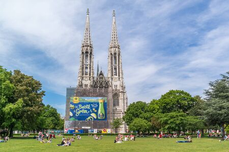 inner city: People relaxing in Sigmund Freud Park and Votive Church at Ringstrasse in inner city of Vienna, Austria