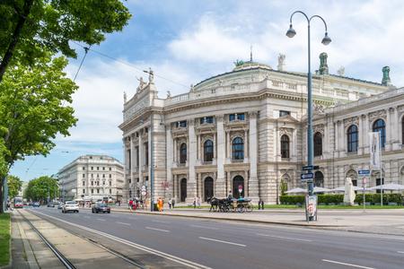 streetscene: Universitatsring Ringstrasse with Hofburg Burgtheater and traffic in downtown Vienna, Austria