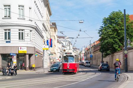 streetscene: Street scene of Rennweg with tram, bicyclist and people walking in Vienna, Austria