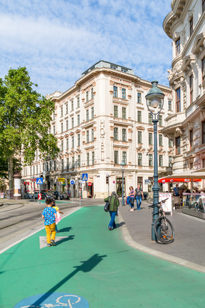 streetscene: Street scene of Schubertring Ringstrasse with bike lane, people and bicycle, Vienna, Austria
